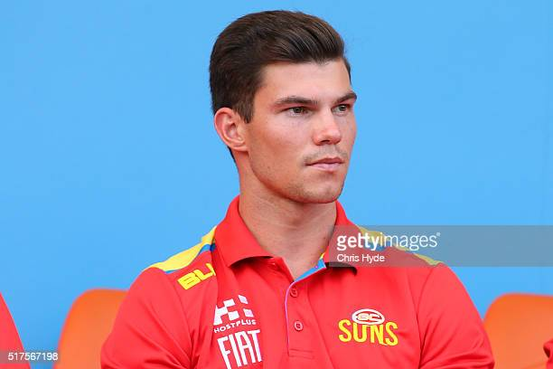 Jaeger O'Meara of the Suns watches from the sideline during the round one AFL match between the Gold Coast Suns and the Essendon Bombers at Metricon...