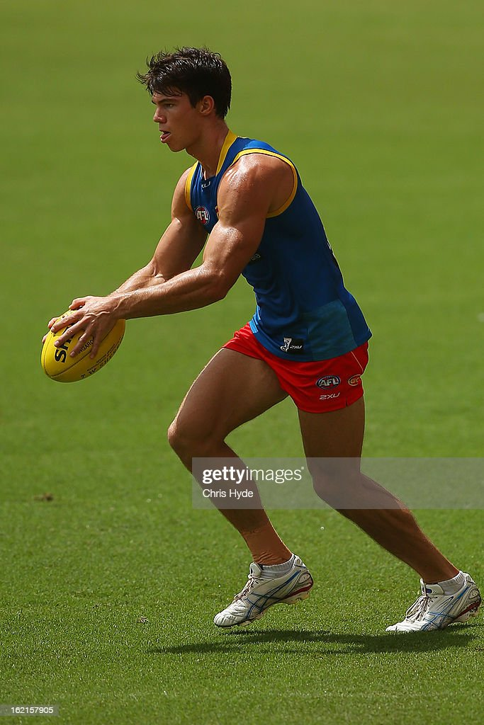 Jaeger O'Meara runs the ball during a Gold Coast Suns AFL training session at Metricon Stadium on February 20, 2013 in Gold Coast, Australia.