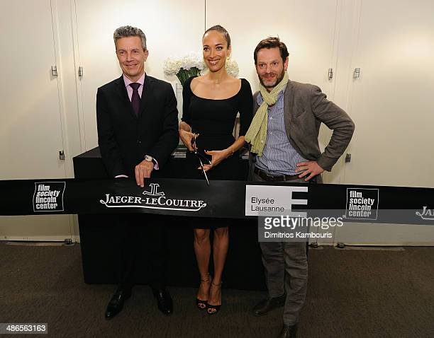 JaegerLeCoultre CEO Daniel Riedo director/actress Carmen Chaplin and director of the Musee d'Elysee Sam Stourdze cut the ribbon for the Charlie...