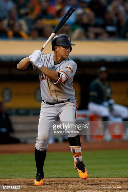 JaeGyun Hwang of the San Francisco Giants at bat against the Oakland Athletics during the fourth inning at the Oakland Coliseum on July 31 2017 in...