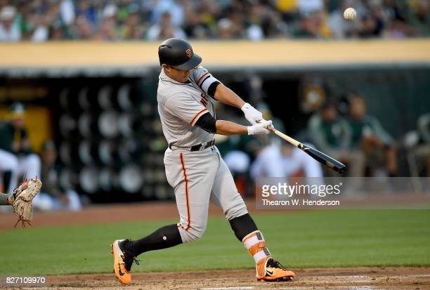 JaeGyun Hwang of the San Francisco Giants bats against the Oakland Athletics in the top of the first inning at Oakland Alameda Coliseum on August 1...