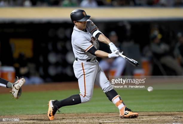 JaeGyun Hwang of the San Francisco Giants bats against the Oakland Athletics in the top of the fifth inning at Oakland Alameda Coliseum on August 1...