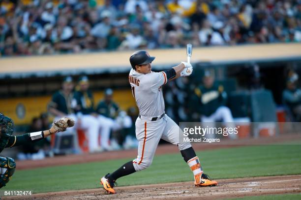 JaeGyun Hwang of the San Francisco Giants bats during the game against the Oakland Athletics at the Oakland Alameda Coliseum on July 31 2017 in...