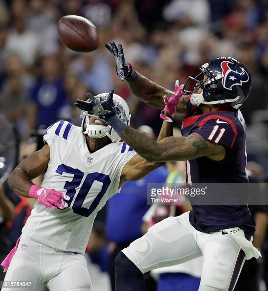 Jaelen Strong of the Houston Texans makes a 36 yard reception defended by Rahsaan Melvin of the Indianapolis Colts in overtime during the NFL game...