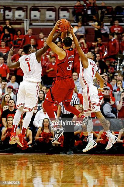 JaeÕSean Tate of the Ohio State Buckeyes and DÕAngelo Russell of the Ohio State Buckeyes attempt to block the shot of Walter Pitchford of the...