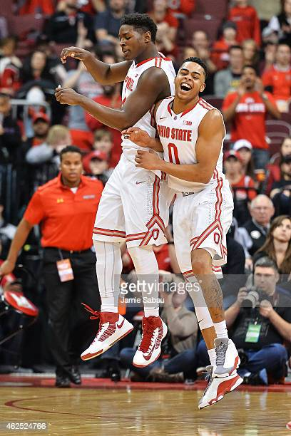 JaeSean Tate of the Ohio State Buckeyes celebrates with DAngelo Russell of the Ohio State Buckeyes against the Maryland Terrapins on January 29 2015...