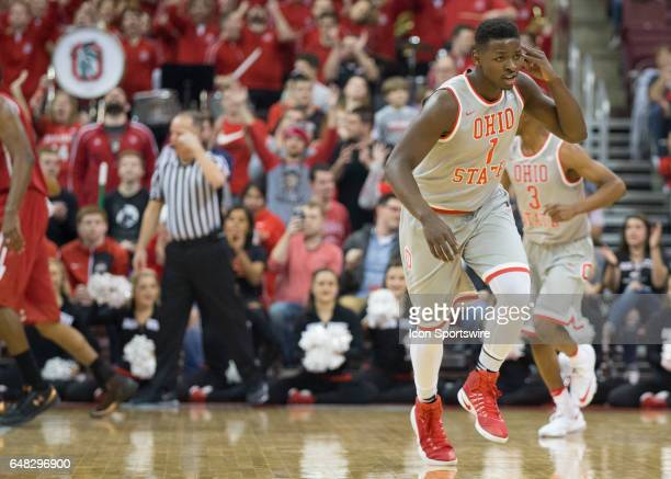 Jae'Sean Tate of the Ohio State Buckeyes reacts to making a three point basket during the first half of the game between the Ohio State Buckeyes and...