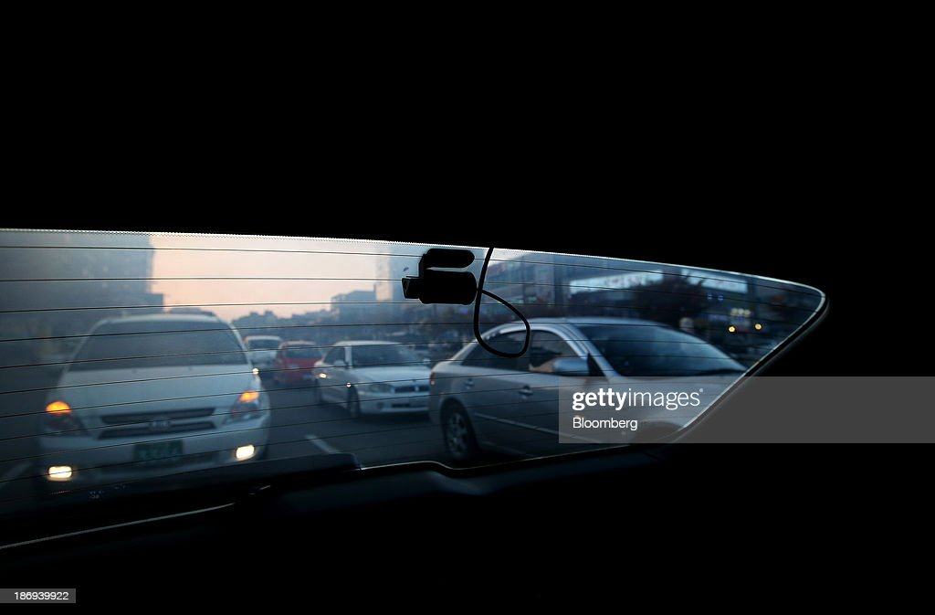 A JaewonCnc IRoad black box camera operates in the rear side of a vehicle in Incheon, South Korea, on Monday, Nov. 4, 2013. Black boxes for cars are devices that automatically record video and audio as well as time, location and speed. Photographer: SeongJoon Cho/Bloomberg via Getty Images