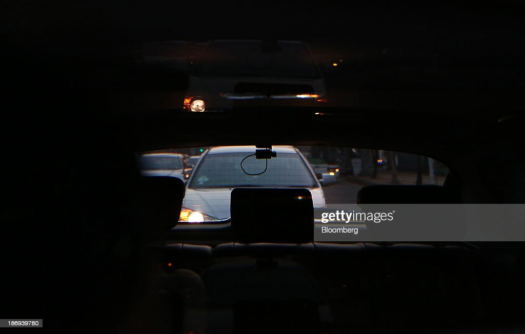 A JaewonCnc IRoad black box camera, operating in the rear side of a vehicle, is seen through a mirror in Incheon, South Korea, on Monday, Nov. 4, 2013. Black boxes for cars are devices that automatically record video and audio as well as time, location and speed. Photographer: SeongJoon Cho/Bloomberg via Getty Images