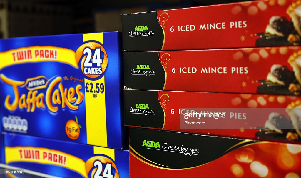 Jaffa Cakes, manufactured by United Biscuits, sit on display beside boxes of Asda supermarket own brand mince pies inside the Community shop, a supermarket for low-income families, in Goldthorpe, U.K., on Monday, Dec. 23, 2013. Company Shop Ltd. created the Community shop for people in, or bordering on, food poverty, selling surplus goods from major retailers at discounted prices. Photographer: Paul Thomas/Bloomberg via Getty Images
