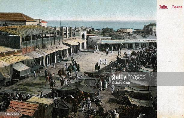Jaffa market with tent stalls and Arab men shopping Late 1800s early 1900s