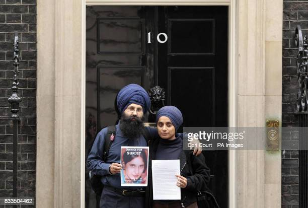 Jagdeesh Singh the brother of Surjit Kaur Athwal and his wife Paramjeet Kaur hand in a petition to 10 Downing Street London requesting a public...