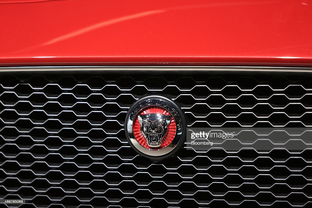 A Jaguar badge sits on the grill of a Jaguar FPace SUV automobile produced by Jaguar Land Rover Plc sits on display during previews to IAA Frankfurt...