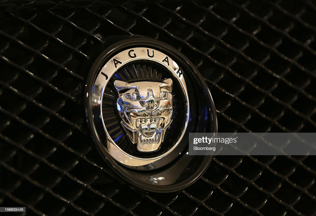 A Jaguar badge sits on the grille of an automobile inside a Jaguar Land Rover auto dealership in Moscow, Russia, on Thursday, Dec. 27, 2012. Tata Motors Ltd.'s Jaguar Land Rover luxury unit signed a letter of intent with Saudi Arabia's government to study the feasibility of setting up a factory to build its models locally. Photographer: Andrey Rudakov/Bloomberg via Getty Images