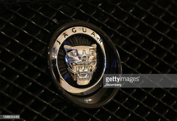 A Jaguar badge sits on the grille of an automobile inside a Jaguar Land Rover auto dealership in Moscow Russia on Thursday Dec 27 2012 Tata Motors...
