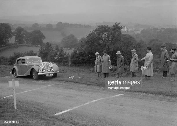 Jaguar SS saloon of BA Hickman competing in the South Wales Auto Club Welsh Rally 1937 Artist Bill Brunell SS Jaguar Saloon 1937 Vehicle Reg No...