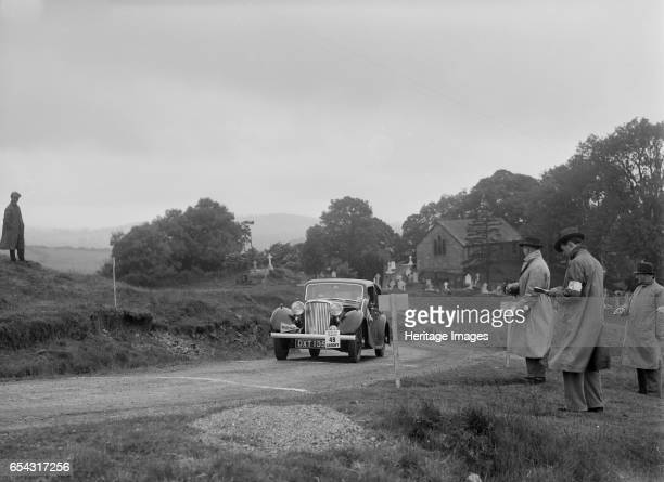 Jaguar SS saloon of HT Lewis competing in the South Wales Auto Club Welsh Rally 1937 Artist Bill Brunell SS Jaguar Saloon 1937 1608 cc Vehicle Reg No...