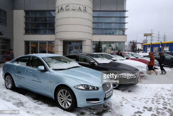 Jaguar XJ series automobiles stand on the forecourt of an independent auto showroom for customers to test in Moscow Russia on Friday Dec 28 2012 Tata...