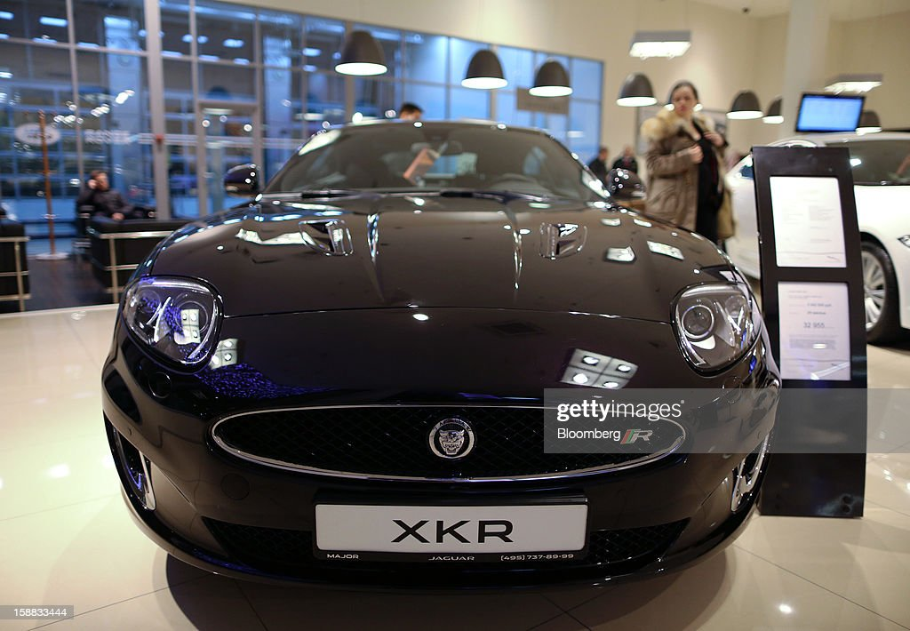 A Jaguar XKR automobile stands on display inside a Jaguar Land Rover auto dealership in Moscow, Russia, on Thursday, Dec. 27, 2012. Tata Motors Ltd.'s Jaguar Land Rover luxury unit signed a letter of intent with Saudi Arabia's government to study the feasibility of setting up a factory to build its models locally. Photographer: Andrey Rudakov/Bloomberg via Getty Images