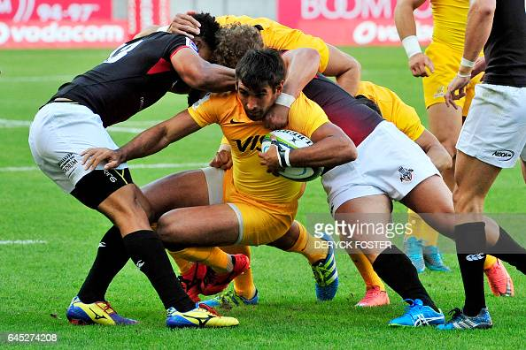 TOPSHOT Jaguares' centre Matias Orlando is tackled during the Super XV rugby union match between South African Southern Kings and Argentinas Jaguares...