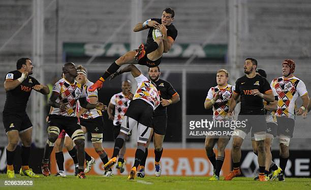 Jaguares' full back Emiliano Boffelli jumps over Southern Kings' flyhalf Elgar Watts during their Super Rugby match at the Jose Amalfitani stadium in...