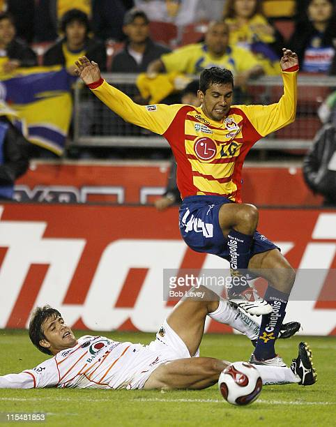 Jaguares' Javier Campora makes a sliding tackle on Morelia's Hugo Sanchez during InterLiga 2007 action between Jaguares and Morelia Jan 4 2007 at...