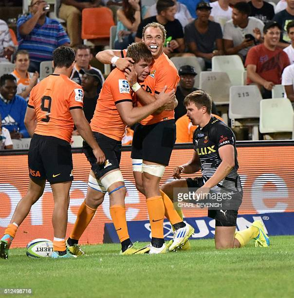 Jaguares palyers celebrate at the end of their Super Rugby match against the Chetaahs on February 26 2016 in Bloemfontein South Africa / AFP / Charl...