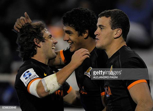 Jaguares' wing Manuel Montero embraces with flyhalf Nicolas Sanchez during a celebration after scored a try against Southern Kings during their Super...