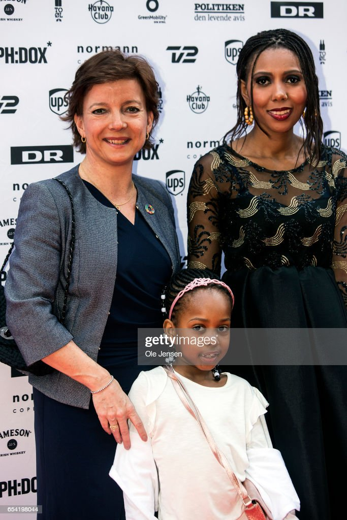 Jaha Dukureh (R) together with Danish Minister for equality, Karen Ellemann, and Dukureh's daughter pose on the red carpet before the world premiere of the documentary 'Jaha's Promise' in the Grand Theatre during the opening of Copenhagen Documentary Film Festival (CPH:DOX) on March 16, 2017 in Copenhagen, Denmark. 'Jaha's Promise' is a documentary with Jaha Dukureh playing herself, about a young woman's fight for her own body and about having the courage to confront her father, politicians and the society at large in order to change the widespread practice of female circumcision (FGM) in Gambia. The documentary is directed and produced by Irish Patrick Farelly and Kate O'Callaghan.