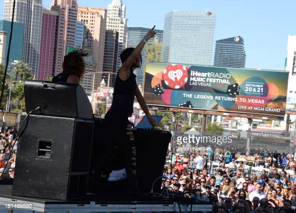Jahan Yousaf and Yasmine Yousaf of Krewella perform onstage during the iHeartRadio Music Festival Village on September 21 2013 in Las Vegas Nevada