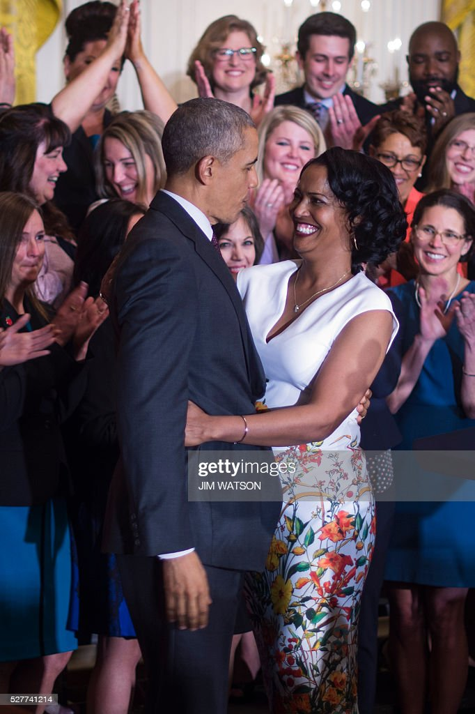 Jahana Hayes (R), a high school history teacher from Waterbury, CT, celebrates winning the 2016 National Teacher of the Year with US President Barack Obama (L) during an event at the White House in Washington, DC, May 3, 2016. / AFP / Jim Watson