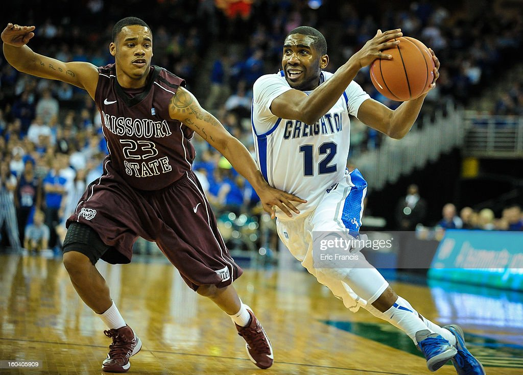 Jahenns Manigat #12 of the Creighton Bluejays drives past Dorrian Williams #23 of the Missouri State Bears during their game at the CenturyLink Center on January 30, 2013 in Omaha, Nebraska. Creighton defeated Missouri State 91-77.