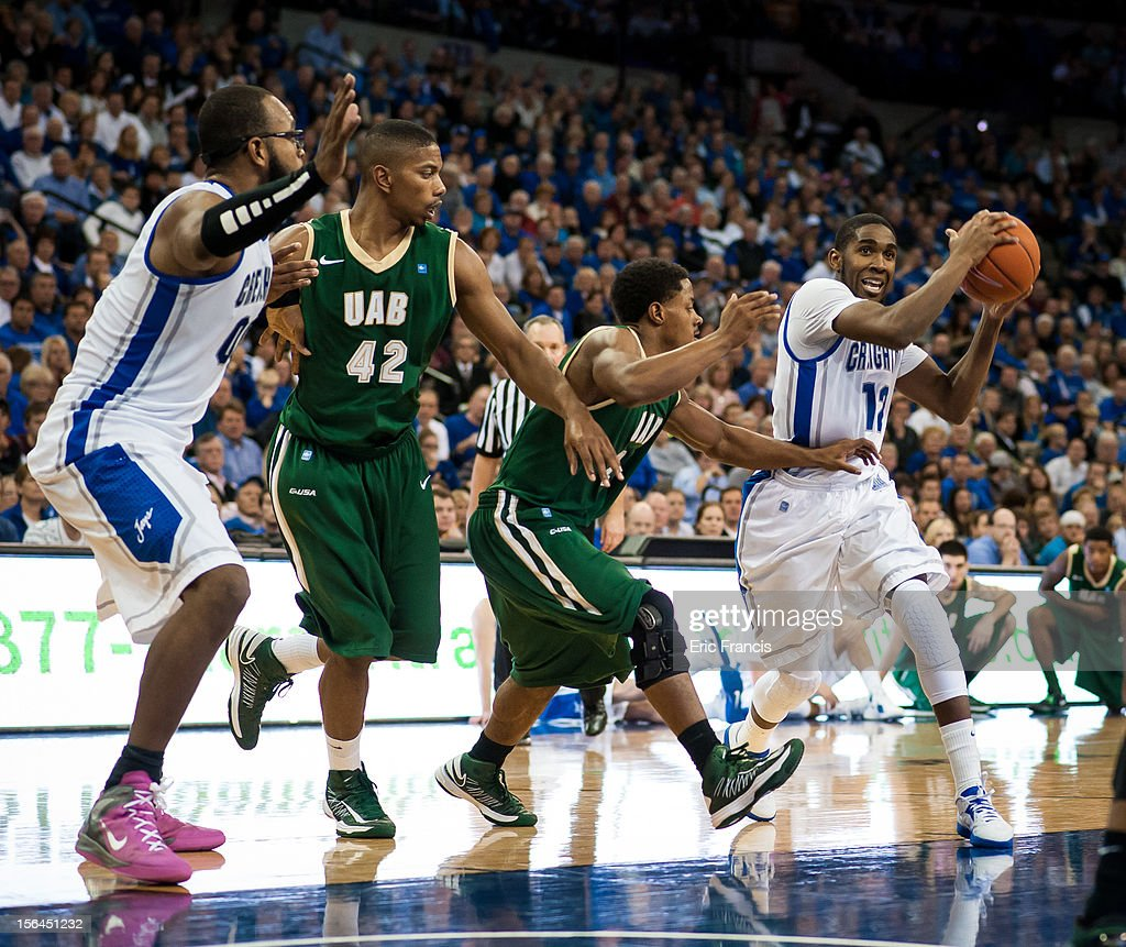 Jahenns Manigat #12 of the Creighton Bluejays looks for an opening around Isiah Jones #23 of the UAB Blazers during their game at CenturyLink Center on November 14, 2012 in Omaha, Nebraska. Creighton beat UAB