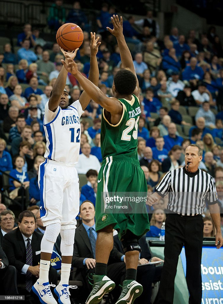 Jahenns Manigat #12 of the Creighton Bluejays shoots over Quincy Taylor #25 of the UAB Blazers during their game at CenturyLink Center on November 14, 2012 in Omaha, Nebraska. Creighton beat UAB
