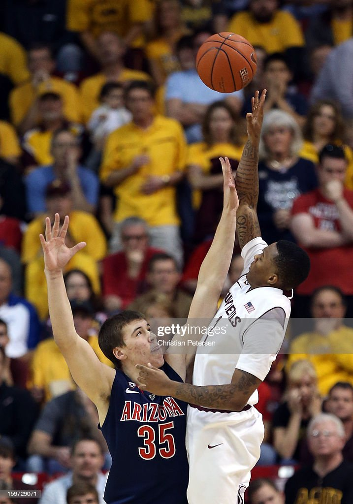 Jahii Carson #1 of the Arizona State Sun Devils puts up a shot over <a gi-track='captionPersonalityLinkClicked' href=/galleries/search?phrase=Kaleb+Tarczewski&family=editorial&specificpeople=8047518 ng-click='$event.stopPropagation()'>Kaleb Tarczewski</a> #35 of the Arizona Wildcats during the college basketball game at Wells Fargo Arena on January 19, 2013 in Tempe, Arizona. The Wildcats defeated the Sun Devils 71-54.
