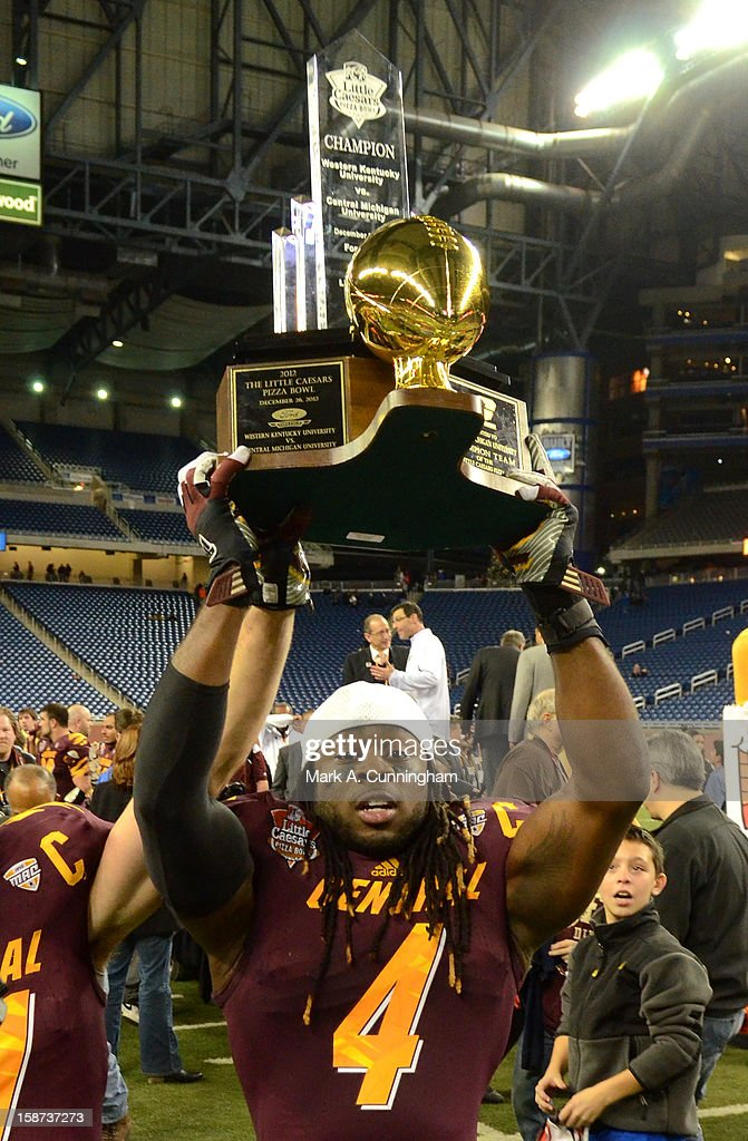 Jahleel Addae #4 of the Central Michigan University Chippewas holds up the Little Caesars Pizza Bowl Championship Trophy after the victory against the Western Kentucky University Hilltoppers at Ford Field on December 26, 2012 in Detroit, Michigan. The Chippewas defeated the Hilltoppers 24-21.