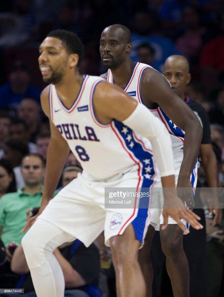 Jahlil Okafor #8 and Emeka Okafor #50 of the Philadelphia 76ers play defense in the fourth quarter of the preseason game against the Boston Celtics at the Wells Fargo Center on October 6, 2017 in Philadelphia, Pennsylvania. The Celtics defeated the 76ers 110-102.
