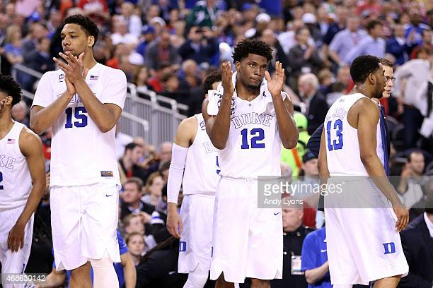 Jahlil Okafor and Justise Winslow of the Duke Blue Devils celebrate after defeating the Michigan State Spartans during the NCAA Men's Final Four...