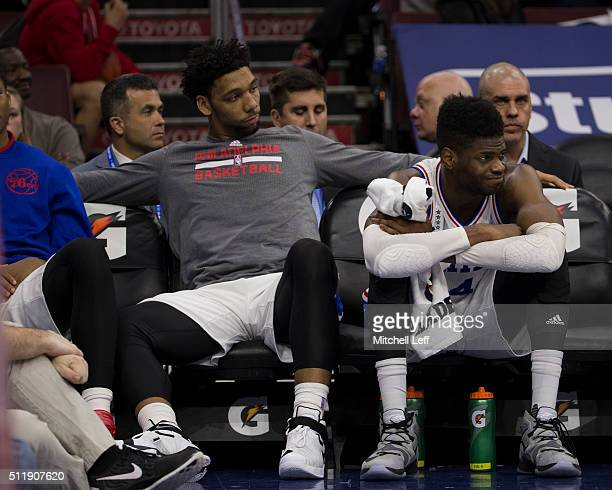 Jahlil Okafor and Nerlens Noel of the Philadelphia 76ers watch the game against the Orlando Magic from the bench on February 23 2016 at the Wells...