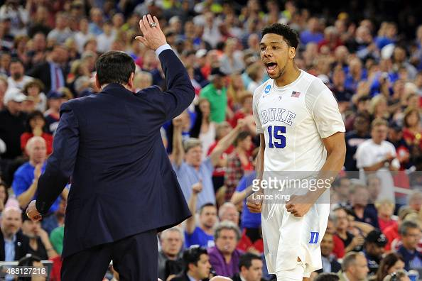 Jahlil Okafor celebrates with Head Coach Mike Krzyzewski of the Duke Blue Devils against the Gonzaga Bulldogs during the South Regional Final of the...