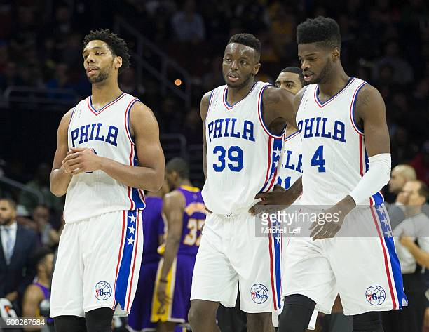 Jahlil Okafor Jerami Grant and Nerlens Noel of the Philadelphia 76ers walk to the bench after a timeout in the game against the Los Angeles Lakers on...