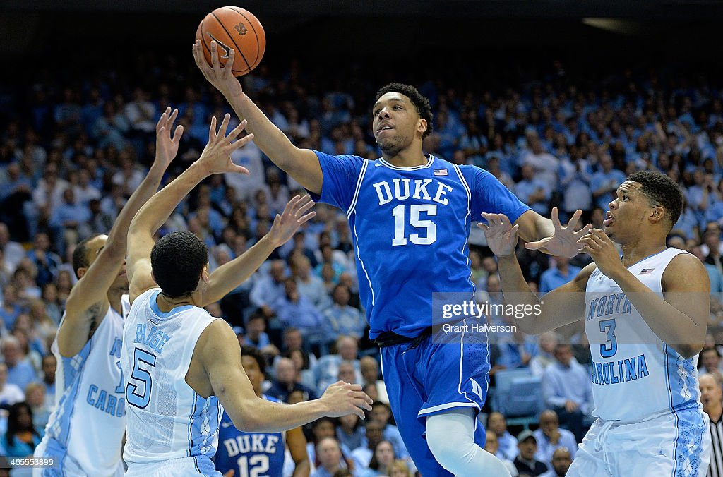 <a gi-track='captionPersonalityLinkClicked' href=/galleries/search?phrase=Jahlil+Okafor&family=editorial&specificpeople=9632986 ng-click='$event.stopPropagation()'>Jahlil Okafor</a> #15 of the Duke Blue Devil drives between defenders <a gi-track='captionPersonalityLinkClicked' href=/galleries/search?phrase=Brice+Johnson+-+Basketball+Player&family=editorial&specificpeople=13908967 ng-click='$event.stopPropagation()'>Brice Johnson</a> #11, <a gi-track='captionPersonalityLinkClicked' href=/galleries/search?phrase=Marcus+Paige&family=editorial&specificpeople=7880805 ng-click='$event.stopPropagation()'>Marcus Paige</a> #5 and <a gi-track='captionPersonalityLinkClicked' href=/galleries/search?phrase=Marcus+Paige&family=editorial&specificpeople=7880805 ng-click='$event.stopPropagation()'>Marcus Paige</a> #5 of the North Carolina Tar Heels during their game at the Dean Smith Center on March 7, 2015 in Chapel Hill, North Carolina.
