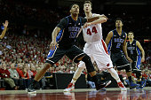 Jahlil Okafor of the Duke Blue Devils boxes out Frank Kaminsky of the Wisconsin Badgers for the rebound during the game at Kohl Center on December 03...