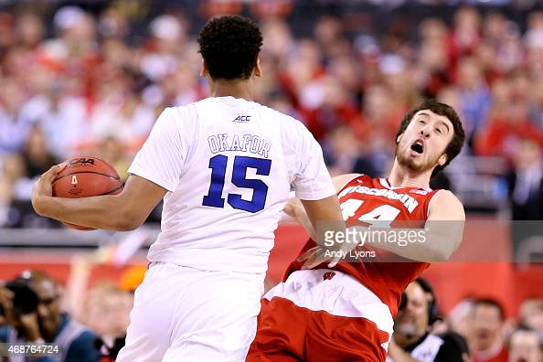 Jahlil Okafor of the Duke Blue Devils collides with Frank Kaminsky of the Wisconsin Badgers and is called for an offensive foul in the first half...