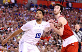Jahlil Okafor of the Duke Blue Devils competes with Frank Kaminsky of the Wisconsin Badgers for position in the first half during the NCAA Men's...