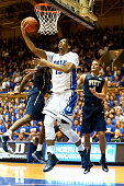 Jahlil Okafor of the Duke Blue Devils drives to the basket against Ryan Luther of the Pittsburgh Panthers during their game at Cameron Indoor Stadium...