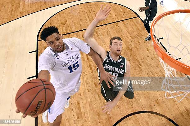 Jahlil Okafor of the Duke Blue Devils drives to the basket against Matt Costello of the Michigan State Spartans in the first half during the NCAA...