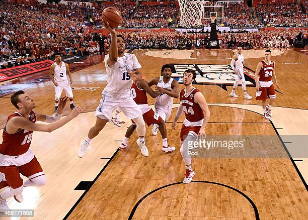 Jahlil Okafor of the Duke Blue Devils drives to the basket in the second half against Sam Dekker of the Wisconsin Badgers during the NCAA Men's Final...