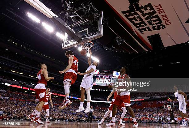 Jahlil Okafor of the Duke Blue Devils dunks against Frank Kaminsky of the Wisconsin Badgers in the first half during the NCAA Men's Final Four...