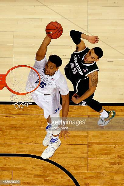 Jahlil Okafor of the Duke Blue Devils goes up for a dunk against Denzel Valentine of the Michigan State Spartans in the second half during the NCAA...